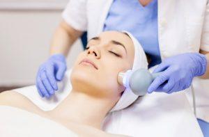 woman receiving skin resurfacing treatment 657671370 300x197 - بهترین روش جوان سازی پوست صورت : لیزر جوانسازی